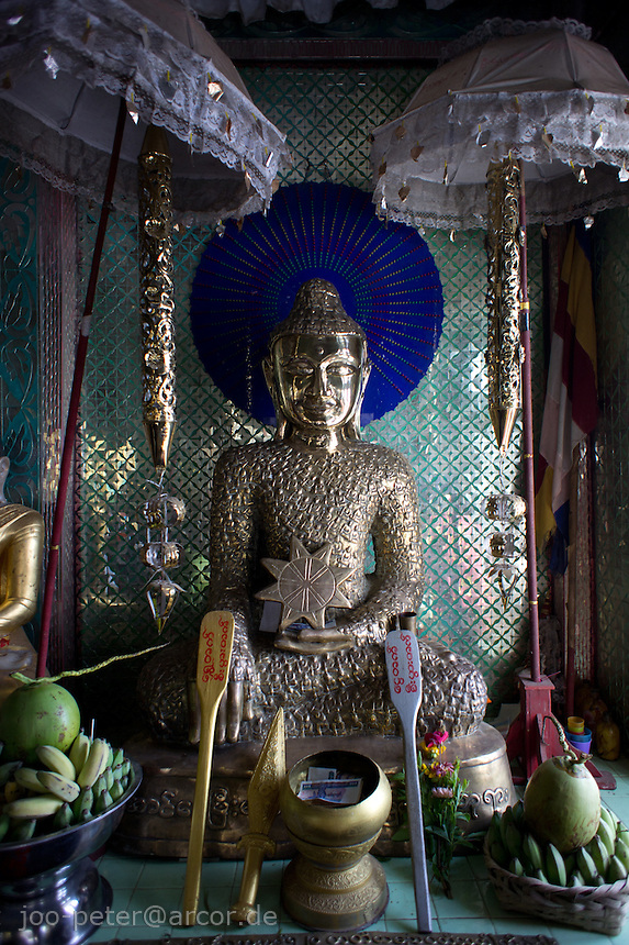 metal sculpture of a buddha  in temple of  Mount Popa, Myanmar, 2011