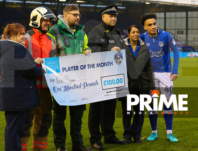 """Oldham Athletic's Kean Bryan received """"Player of the month award"""" for November by emergency services ahead of the Sky Bet League 1 match between Oldham Athletic and Northampton Town at Boundary Park, Oldham, England on 9 December 2017. Photo by Juel Miah / PRiME Media Images."""