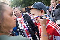 MOSCOW, RUSSIA - June 14, 2018: A Russia fan has his face painted before the opening match of the FIFA 2018 World Cup at Luzhniki Stadium.