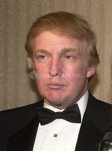 Donald Trump visits the Bloomberg hospitality suite prior to the White House Correspondents Association Dinner at the Washington Hilton Hotel in Washington, DC on April 28, 2001.<br /> Credit: Ron Sachs / CNP/MediaPunch