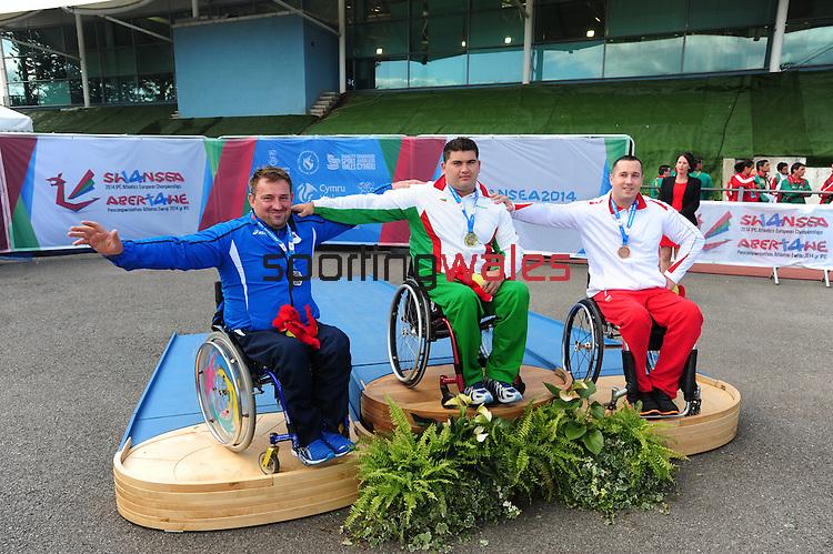 IPC European Athletics Championship 2014<br /> Swansea University<br /> <br /> Medal ceremony: Men's shot put F53/54/55.<br /> Gold medal: Ruzhdi Ruzhdi (BUL)<br /> Silver medal: Drazenko Mitrovic (SRB)<br /> Bronze medal: Karol Kozun (POL)<br /> <br /> 23.08.14<br /> Chris Vaughan-SPORTINGWALES