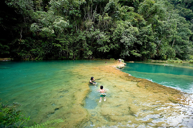 Semuc Champey, a natural monument in the Alta Verapaz region of Guatemala, consists of a natural limestone bridge and natural pools with turquoise-coloured waters from the Cahabón River.