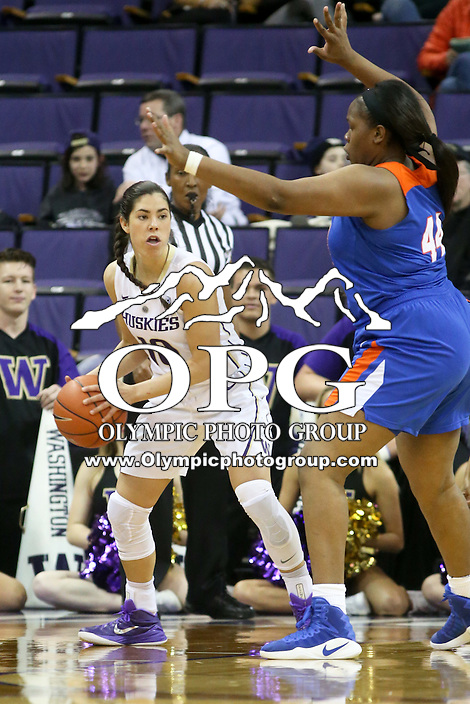 SEATTLE, WA - DECEMBER 18: Washington's #10 Kelsey Plum looks for an opening to the basket against Savannah State.  Washington won 87-36 over Savannah State at Alaska Airlines Arena in Seattle, WA.