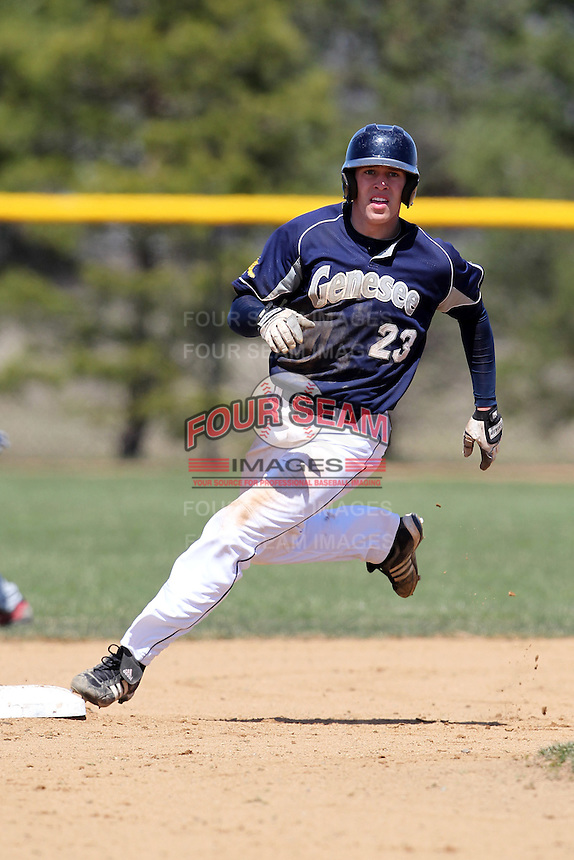 Genesee Community College Cougars outfielder Jacob Featherstone #23 during a game against the Ithaca JV team at Genesee Community College on April 9, 2011 in Batavia, New York.  Photo By Mike Janes/Four Seam Images