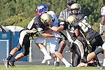 Palos Verdes, CA 09/24/10 - Brandon Fontenot (Serra #5), Shaquille Richard (Serra #22), Jason Gibson (Serra #19), Mickey O'crowley (Peninsula #53) in action during the Serra-Peninsula varsity football game at Peninsula High School.