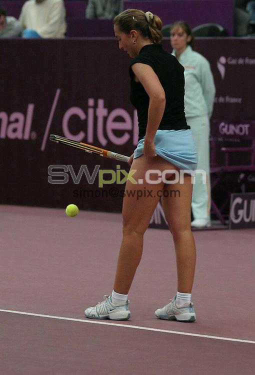 PIX: Tennis. WTA Open Gaz de France/Paris Open, Stade Pierre de Coubertin, Paris, 7-14th February 2005...COPYRIGHT PICTURE>> SIMON WILKINSON>>0870 092 0092>>..Paris-based Tunisian Selima Sfar on her way to a 4-6 6-4 6-1 win over Cara Black of Zimbabwe.