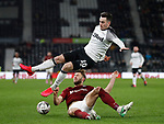 Tom Lawrence of Derby County tackles by Charlie Goode of Northampton during the FA Cup match at the Pride Park Stadium, Derby. Picture date: 4th February 2020. Picture credit should read: Darren Staples/Sportimage