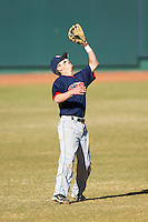 Shortstop Sam Phillips #4 of the Shippensburg Red Raiders makes a catch in shallow left field against the Catawba Indians at Newman Park on February 12, 2011 in Salisbury, North Carolina.  Photo by Brian Westerholt / Four Seam Images