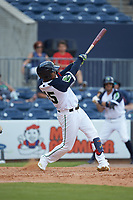 Cristian Pache (15) of the Gwinnett Stripers follows through on his swing against the Scranton/Wilkes-Barre RailRiders at Coolray Field on August 18, 2019 in Lawrenceville, Georgia. The RailRiders defeated the Stripers 9-3. (Brian Westerholt/Four Seam Images)