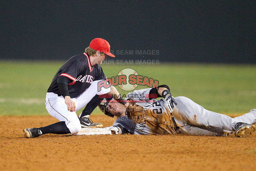 Will Craig (22) of the Wake Forest Demon Deacons avoids the tag from Andrew Pope (12) of the Davidson Wildcats as he slides into second base with a double at Wilson Field on March 19, 2014 in Davidson, North Carolina.  The Wildcats defeated the Demon Deacons 7-6.  (Brian Westerholt/Four Seam Images)