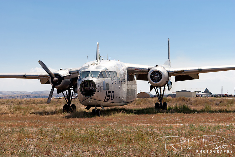 C-119 Flying Boxcar sits in the Greybull, Wyoming, storage area awaiting a new owner or the scrappers torch prior to auction in August of 2006.<br /> <br /> Hawkins and Powers was founded in 1969 by Dan Hawkins and Gene Powers. H&amp;P shut their doors at the end of 2005 and auctioned off their assets to satisfy nearly $15 million that it owed to creditors.