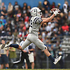 Nick Platia #22 of Oceanside catches a pass in stride for a 52-yard touchdown reception in the third quarter of a Nassau County Conference I varsity football game against host Baldwin High School on Saturday, Oct. 6, 2018. Oceanside won by a score of 35-0.