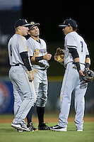 (L-R) Billy Fleming (8), Vicente Conde (4) and Angel Aguilar (7) hang out during a pitching change in the game against the Hickory Crawdads at L.P. Frans Stadium on August 25, 2015 in Hickory, North Carolina.  The Crawdads defeated the RiverDogs 7-4.  (Brian Westerholt/Four Seam Images)