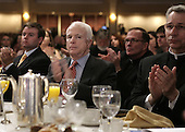 Presumptive Republican presidential nominee United States Senator John McCain (Republican of Arizona) applauds U.S. President George W. Bush at the National Catholic Prayer Breakfast in Washington on April 18, 2008.<br /> Credit: Yuri Gripas / Pool via CNP