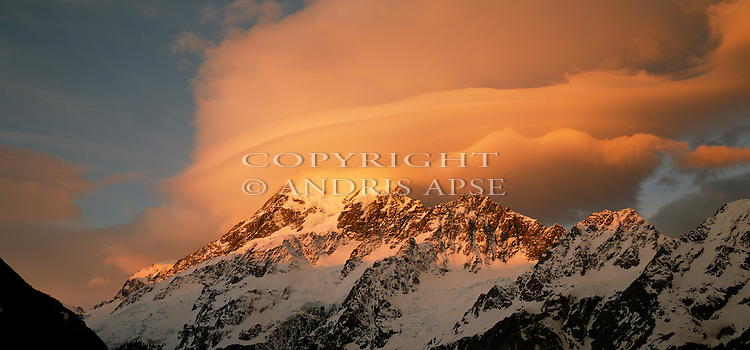 Sunset on  Mount Cook in Mount Cook National Park. Lenticular cloud over summit of the mountain. New Zealand