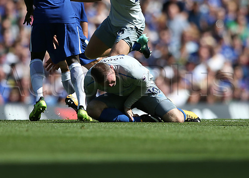 27th August 2017, Stamford Bridge, London, England; EPL Premier League football, Chelsea versus Everton; Wayne Rooney of Everton is down after being tackled by Marco Alonso of Chelsea