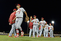Palm Beach Cardinals shortstop Alex Mejia (7), third baseman Breyvic Valera (32), first baseman David Washington (26) pitcher Dixon Llorens (3) after a game against the Bradenton Marauders on April 9, 2014 at McKechnie Field in Bradenton, Florida.  Palm Beach defeated Bradenton 3-1.  (Mike Janes/Four Seam Images)