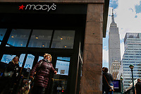 NEW YORK, NY - FEBRUARY 25:  People walk in front of the Macy's headquarter as the Empire State Building is seen at the background on February 25, 2019 in Manhattan, New York. Earnings reports of $2.53 is expected for Macy's Inc. with a share on sales of $8.4 billion before the market opens Feb. 26,.  (Photo by Eduardo Munoz Alvarez/VIEWpress)
