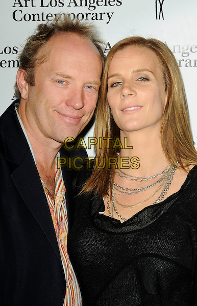 ANDREW TAYLOR & RACHEL GRIFFITHS .The Art Los Angeles Contemporary Art Fair at Pacific Design Center on January 28, 2010 in West Hollywood, California, USA..January 28th, 2010.headshot portrait black silver gold chain necklaces married husband wife .CAP/ROT.©Lee Roth/Capital Pictures