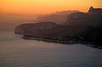 Sun setting over the limestone rock faces of Les Calanaques, Marseille, France.