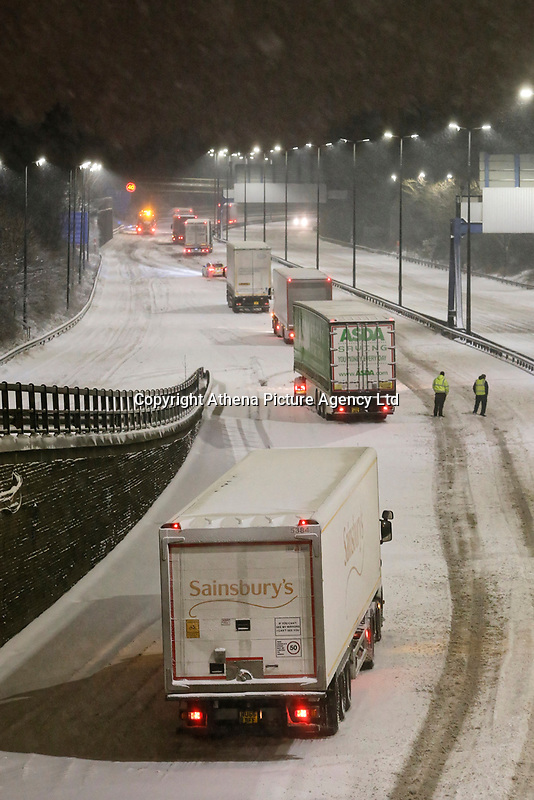 WEATHER PICTURE WALES<br /> Pictured:  Articulated lorries remain stuck on the M4 motorway in the early hours of the morning, near Newport because of the snow in south Wales, UK.<br /> Re: Snow caused by the Beast from the East hits parts of the UK.