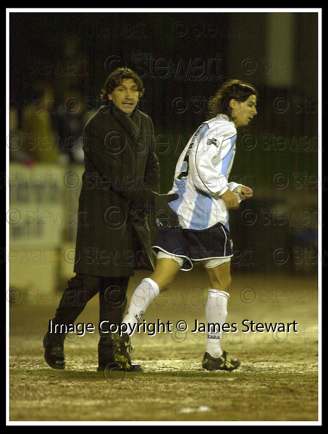08/12/2001                 Copyright Pic : James Stewart .Ref : DSC_8205                          .File Name : stewart10-st johnstone v dundee.IVANO BONNETTI GIVES BETO CARRANZA A TOUCH OF ENCOURAGEMENT......James Stewart Photo Agency, Stewart House, Stewart Road, Falkirk. FK2 7AS      Vat Reg No. 607 6932 25.Office     : +44 (0)1324 630007     .Mobile  : + 44 (0)7721 416997.Fax         :  +44 (0)1324 630007.E-mail  :  jim@jspa.co.uk.If you require further information then contact Jim Stewart on any of the numbers above.........