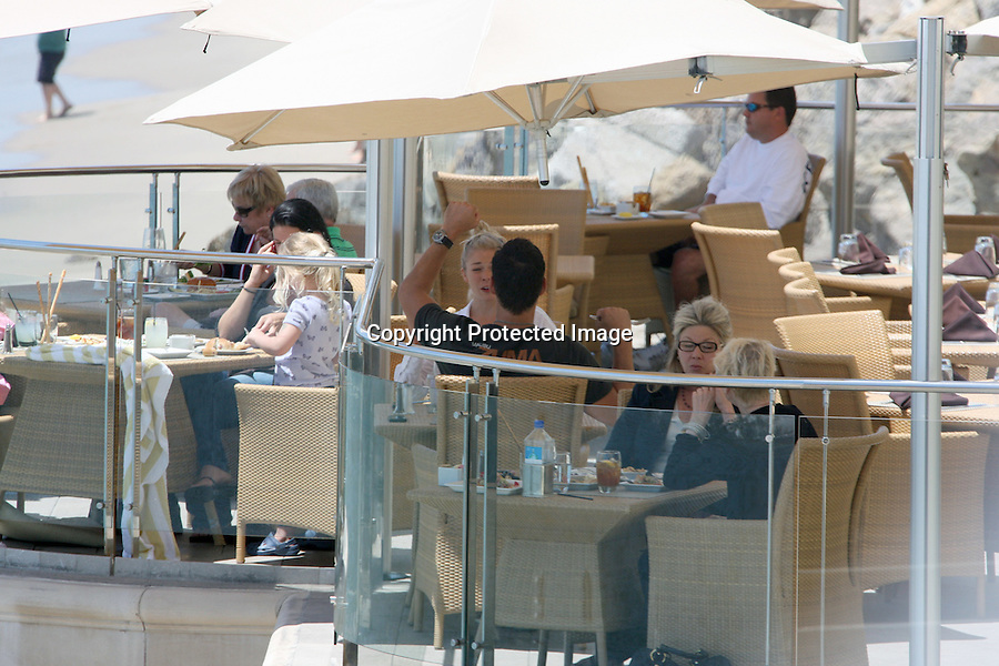 July 17th 2010   Exclusive ..LeAnn Rimes eating lunch at the Malibu Inn with her boyfriend Cibrian over looking the beach in Malibu California. ...AbilityFilms@yahoo.com.805-427-3519.www.AbilityFilms.com.