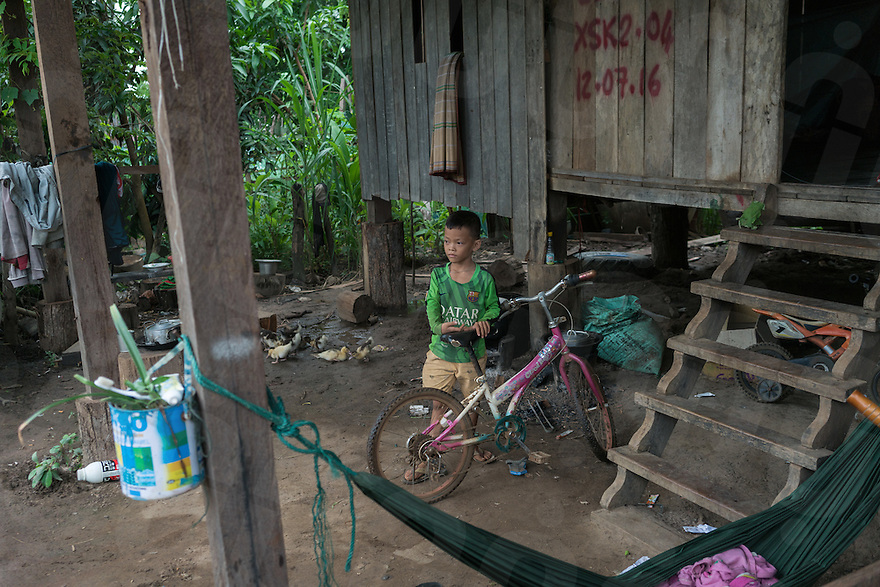 August 17, 2016 - Srekor village, Stung Treng (Cambodia). A kid play with his bycicle outiside his house in Srekor village. he village and the sorrounding areas will be soon be flooded because of the construction of the Lower Sesan II dam. © Thomas Cristofoletti / Ruom