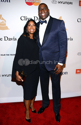 BEVERLY HILLS, CA -  FEBRUARY 7: Magic Johnson arrives at the 2015 Pre-Grammy Gala & Grammy Salute to Industry Icons at the Beverly Hilton Hotel on February 7, 2015 in Beverly Hills, California. Credit: PGTW/MediaPunch