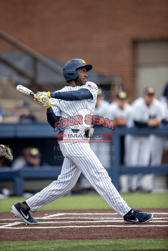 Michigan Wolverines outfielder Christian Bullock (5) follows through on his swing against the Rutgers Scarlet Knights on April 27, 2019 in the NCAA baseball game at Ray Fisher Stadium in Ann Arbor, Michigan. Michigan defeated Rutgers 10-1. (Andrew Woolley/Four Seam Images)