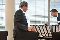 In einer nichtoeffentlichen Sondersitzung des Bundestagsausschuss fuer Verkehr und digitale Infrastruktur, am Mittwoch den 24. Juli 2019, berichtete Bundesverkehrsminister Andreas Scheuer (CSU) (im Bild) dem Ausschuss ueber Vertragsinhalte und moegliche Schadensersatzansprueche im Hinblick auf Kuendigungen von Vertraegen zur Infrastrukturabgabe (MAUT) in Folge des Urteils des Europaeischen Gerichtshofs (EuGH). Das Verkehrsministerium hatte, noch bevor die Einfuehrung der MAUT rechtsgueltig haette werden koenne, millionenschwere Vertraege mit Firmen abgeschlossen.<br /> Im Bild: Der Verkehrsminister mit den Vetraegen.<br /> 24.7.2019, Berlin<br /> Copyright: Christian-Ditsch.de<br /> [Inhaltsveraendernde Manipulation des Fotos nur nach ausdruecklicher Genehmigung des Fotografen. Vereinbarungen ueber Abtretung von Persoenlichkeitsrechten/Model Release der abgebildeten Person/Personen liegen nicht vor. NO MODEL RELEASE! Nur fuer Redaktionelle Zwecke. Don't publish without copyright Christian-Ditsch.de, Veroeffentlichung nur mit Fotografennennung, sowie gegen Honorar, MwSt. und Beleg. Konto: I N G - D i B a, IBAN DE58500105175400192269, BIC INGDDEFFXXX, Kontakt: post@christian-ditsch.de<br /> Bei der Bearbeitung der Dateiinformationen darf die Urheberkennzeichnung in den EXIF- und  IPTC-Daten nicht entfernt werden, diese sind in digitalen Medien nach §95c UrhG rechtlich geschuetzt. Der Urhebervermerk wird gemaess §13 UrhG verlangt.]