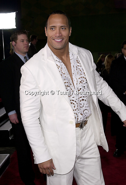 Dwayne Johnson (The Rock) arriving at the premiere of Scorpion King at the Universal Amphitheatre in Los angeles. April 17, 2002.           -            JohnsonDwayne_TheRock03.jpg