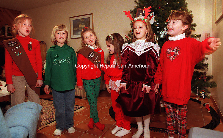 MIDDLEBURY, CT 12/13/98 --1213JH02.tif--Girls from Brownie Troop 4692 of Middlebury break into a Christmas song after decorating a tree at the home of their co-leader Deborah Colella in Middlebury Sunday. They had earlier in the afternoon sung for the senior citizens who reside at Woodside Heightsin Middlebury as their troop community project. From left are: Kaitlyn Wengler, Chelsea Cronin, Katherine Tzepos, Kim Ferrara, Lauren Colella and Alyssa Pelletier. JOHN HARVEY staff photo STANDALONE PHOTO.