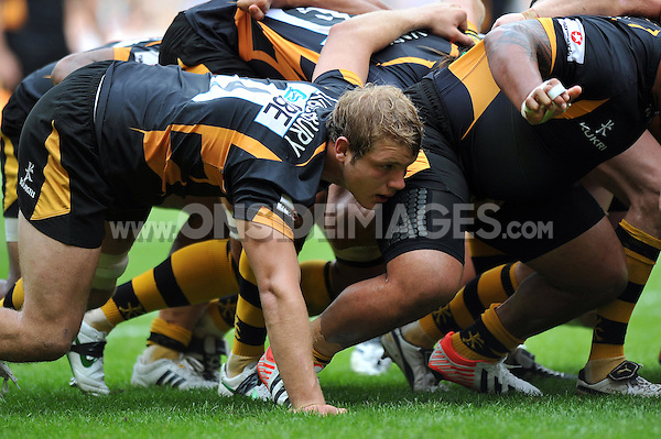 Joe Launchbury in action at a scrum. Aviva Premiership Double Header match, between London Wasps and Harlequins on September 1, 2012 at Twickenham Stadium in London, England. Photo by: Patrick Khachfe / Onside Images