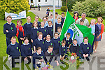 Principal Brendan Dennehy and pupils of St Joseph's NS Castlemaine unvail their Green flag in the school on Monday..