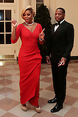 Singer Mary J Blige, left, and Kendu Isaacs arrive to a state dinner hosted by U.S. President Barack Obama and U.S. First Lady Michelle Obama in honor of French President Francois Hollande at the White House in Washington, D.C., U.S., on Tuesday, Feb. 11, 2014. Obama and Hollande said the U.S. and France are embarking on a new, elevated level of cooperation as they confront global security threats in Syria and Iran, deal with climate change and expand economic cooperation. <br /> Credit: Andrew Harrer / Pool via CNP