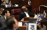 Nevada Sen. Kelvin Atkinson, D-North Las Vegas, watches votes tally on the Senate floor at the Legislative Building in Carson City, Nev., on Friday, April 3, 2015. <br /> Photo by Cathleen Allison