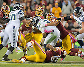 Seattle Seahawks quarterback Russell Wilson (3) is sacked by <br /> Washington Redskins left outside linebacker Ryan Kerrigan (91) in first quarter action at FedEx Field in Landover, Maryland on Monday, October 6, 2014.<br /> Credit: Ron Sachs / CNP
