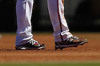 Spikes or sports shoe for baseball, legs, dirt, clay, and feet for Major League Baseball runner, Diamondbacks, Surprise Stadium. Cactus league 2012.<br />