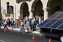 A crowd of people leave the auditorium after hearing environmental activist, Nobel Peace Prize Laureate, and former Vice President Al Gore's West Coast Green keynote address. The SolaRover Mobile Solar Power System is being showcased outside. It provides a cleaner alternative to diesel generators. This model consists of fourteen 175-watt solar panels and 42kWhr battery storage. West Coast Green is the nation?s largest conference and expo dedicated to green innovation, building, design and technology. The conference featured over 380 exhibitors, 100 presenters, and 14,000 attendees. Location: San Jose Convention Center in Silicon Valley (San Jose, California, USA), September 25-27, 2008