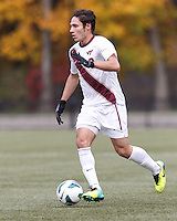 Virginia Tech defender Bradley Vorv (8) brings the ball forward. Boston College (maroon) defeated Virginia Tech (Virginia Polytechnic Institute and State University) (white), 3-1, at Newton Campus Field, on November 3, 2013.