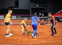 The Hague, The Netherlands, Februari 4, 2020,  Sportcampus , FedCup  Netherlands - Balarus, Dutch team practise, Playing spike ball, ltr: Kiki Bertens, Arantxa Rus,  coach Elise Tamaela,  and Captain Paul Haarhuis.<br /> Photo: Tennisimages/Henk Koster