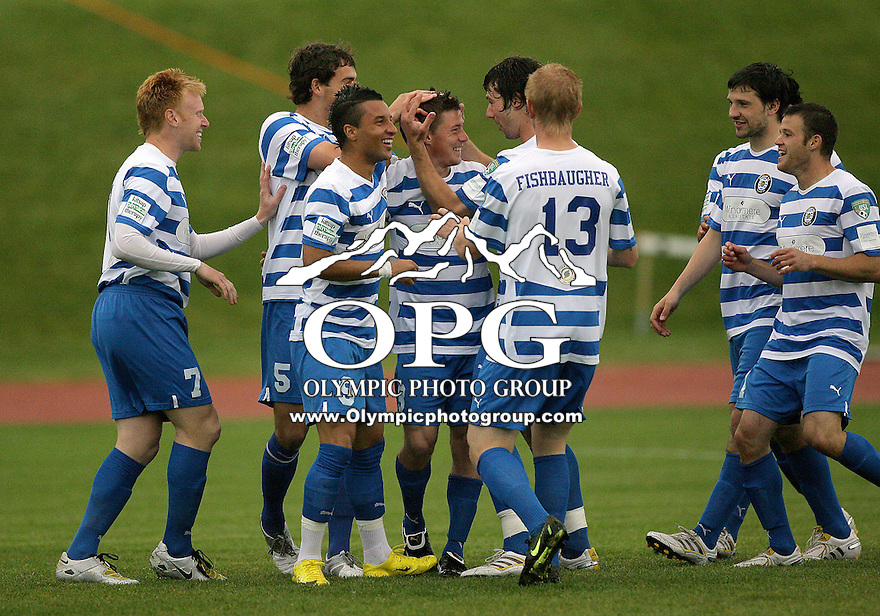 22 May 2010:   Kitsap Pumas players celebrate with #3 Mark Lee after he scored the first goal of the game against the Washington Crossfire.  The Kitsap Pumas defeated the Washington Crossfire 2-0 at Bremerton High School in Bremerton, WA.