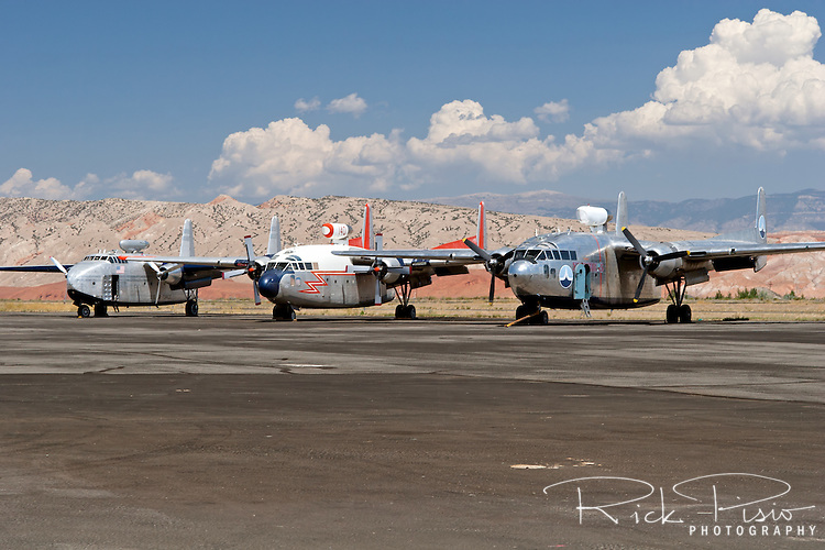 "Hawkins and Powers aircraft on the tarmac in Greybull, Wyoming, prior to auction in 2006. From left to right: C-82 Packet N9701F, C-119 Flying Boxcar configured for firefighting, and a C-119 Flying Boxcar configured as a transport and utilized in the remake of the movie ""Flight of the Phoenix."""