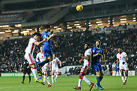 George Francomb of AFC Wimbledon heads goal wards during the Sky Bet League 1 match between MK Dons and AFC Wimbledon at stadium:mk, Milton Keynes, England on 13 January 2018. Photo by David Horn.