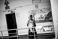 Madvi Parmila (11) dries her clothes at the corridor at Sukma Football Academy girls 'hostel. Sukma, Chattisgarh, India. Arindam Mukherjee