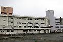 """Minamisanriku, Miyagi, Japan - The ruins of a public Shizugawa hospital in Minamisanriku, one year after the tsunami. The Latin group of volunteers """"Todos con Japon"""" visits Miyagi area during this Golden Week."""