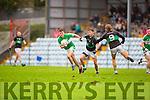 David O'Sullivan Legion goes past Colin o'Brien and Michael Dorgan Nemo Rangers during the AIB Munster club SFC clash in Pairc Uí Rinn on Sunday