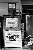 USA.2003..American Newspaper boxes advertise the war in Iraq.