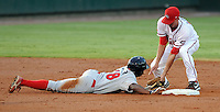 Shortstop Derrik Gibson (18) of the Greenville Drive taks out Leandro Castro (18) of the Lakewood BlueClaws in a pickoff play in Game 1 of the South Atlantic League Championship Series on Sept. 13, 2010, at Fluor Field at the West End in Greenville, S.C. Photo by: Tom Priddy/Four Seam Images